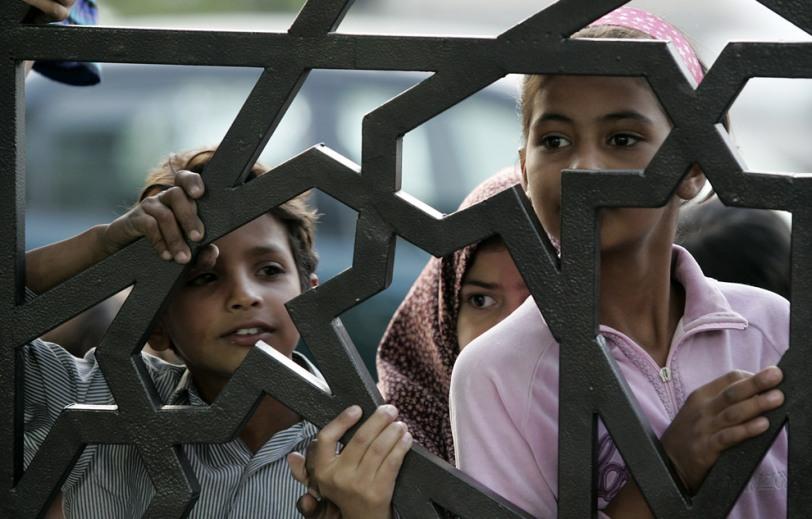 Refugee children waiting for food in Ramadan