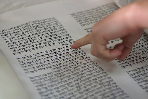 The Torah, using the left hand to follow