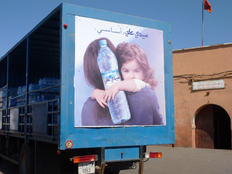A truck with an advertisement using a child